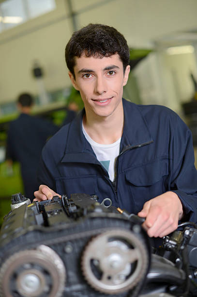 Student working on a car engine stock photo