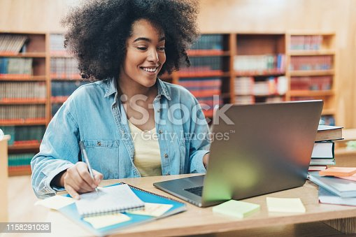 African-American ethnicity student working in a public library