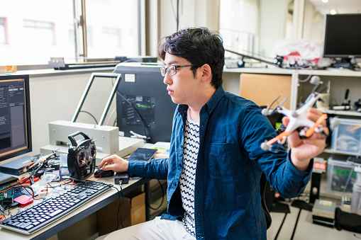 University student working on his self piloting drone design. Kyoto, Japan. May 2016