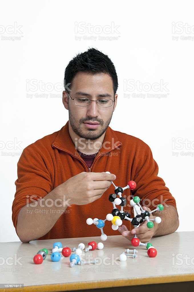 Student working with chemistry models (isolated) - II royalty-free stock photo