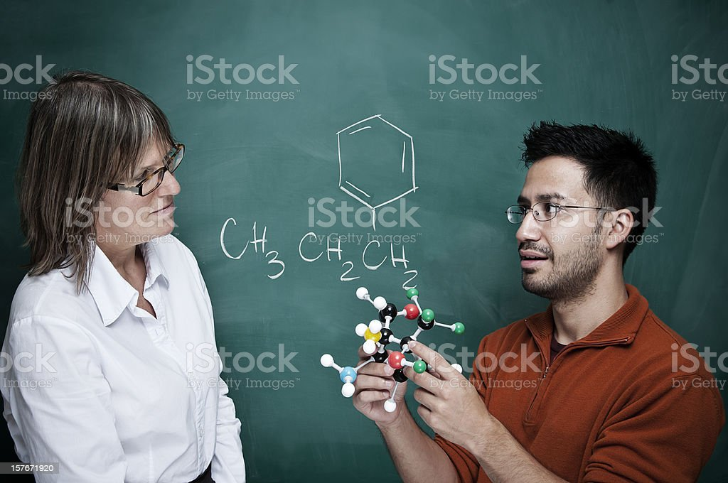 Student working with chemistry models (blackboard) - III royalty-free stock photo