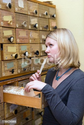 668340340istockphoto student working with library card index 116424589