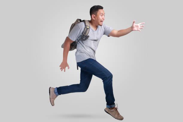 遅刻する心配している学生 - スタジオ 日本人 ストックフォトと画像