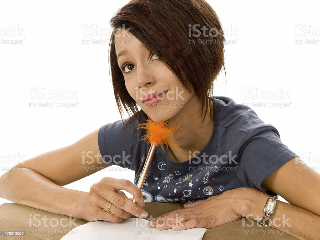 Student Writing and Thinking royalty-free stock photo