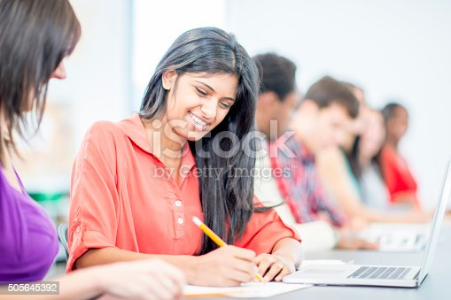 istock Student Writing Down Her Answer 505645392