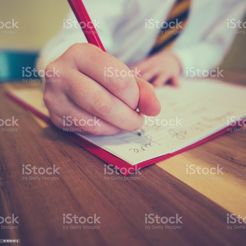Student Writing Homework stock photo