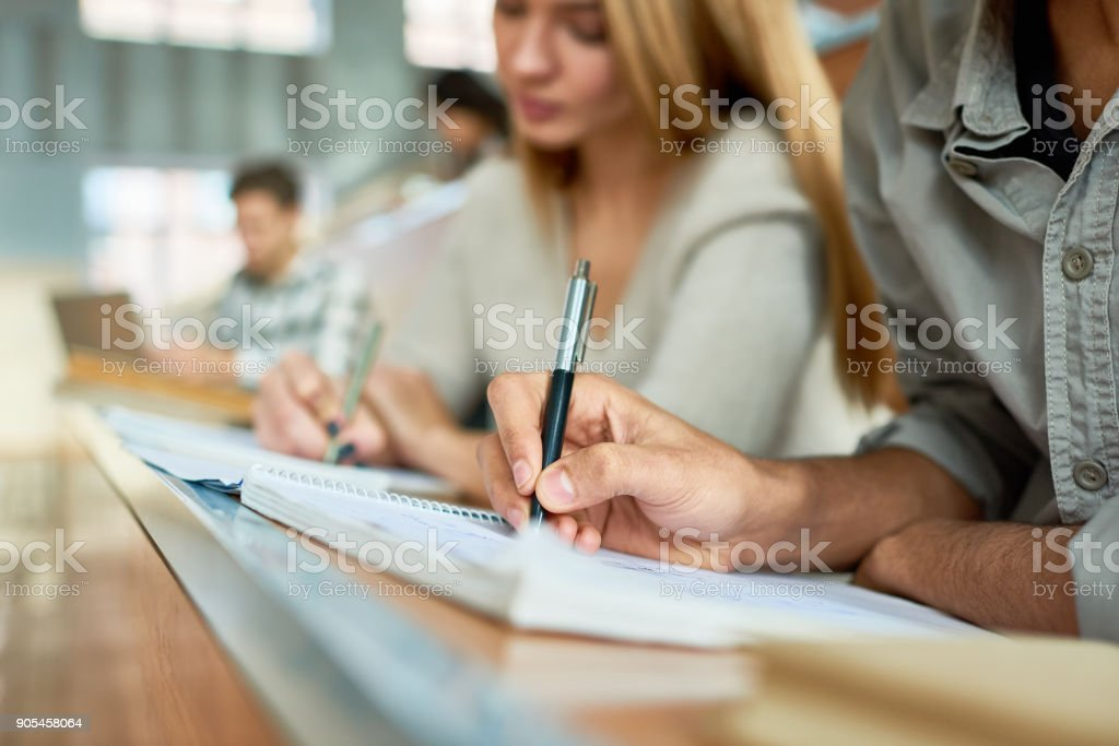 Student Writing Lecture Close Up stock photo