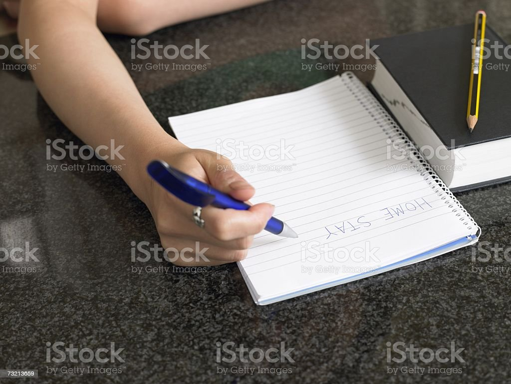 Student writing royalty-free stock photo