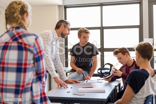 istock Students and teacher with virtual reality glasses 1032472706