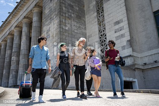 Students and a teacher on an outdoor history class trip