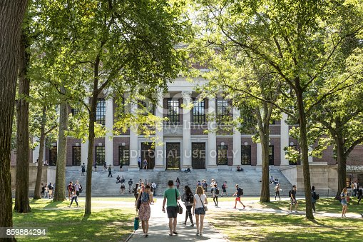istock Students and tourists rest in lawn chairs in Harvard Yard, the open old heart of Harvard University campus 859884294