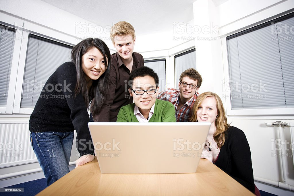 Students around laptop royalty-free stock photo