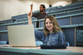 istock Students Asking a Question in Class with a Big Smile 1191812099