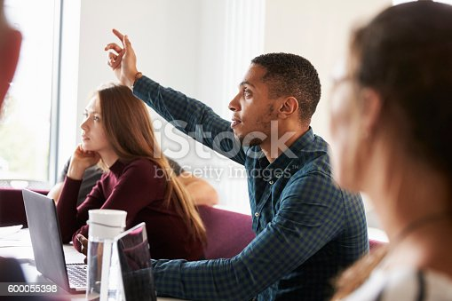 istock Students Asking Question Whilst Attending Lecture On Campus 600055398