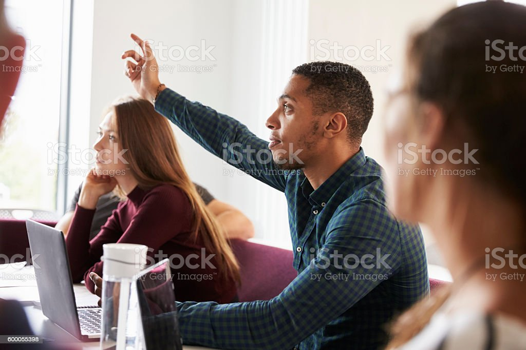 Students Asking Question Whilst Attending Lecture On Campus stock photo