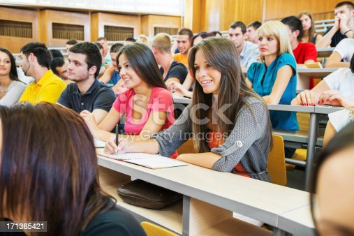 istock Students at lecture hall listening attentively. 171365421