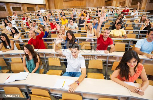 600055398 istock photo Students at lecture hall raising their hands to answer question. 175506771