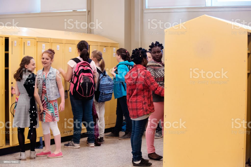 Students at locker happy because it is school's out royalty-free stock photo