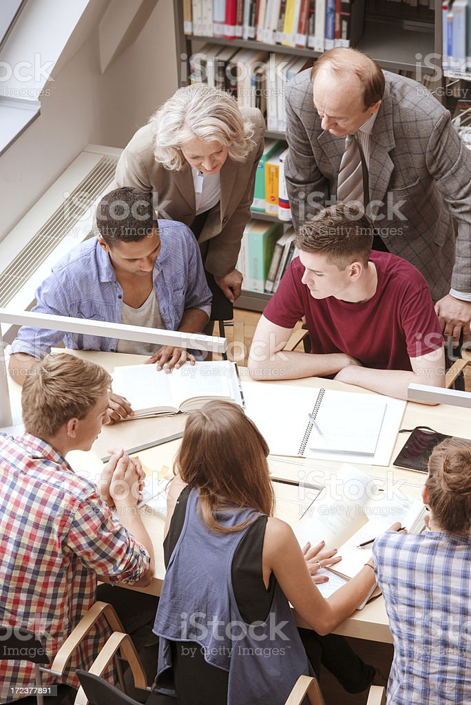 Students At Table With Books royalty-free stock photo