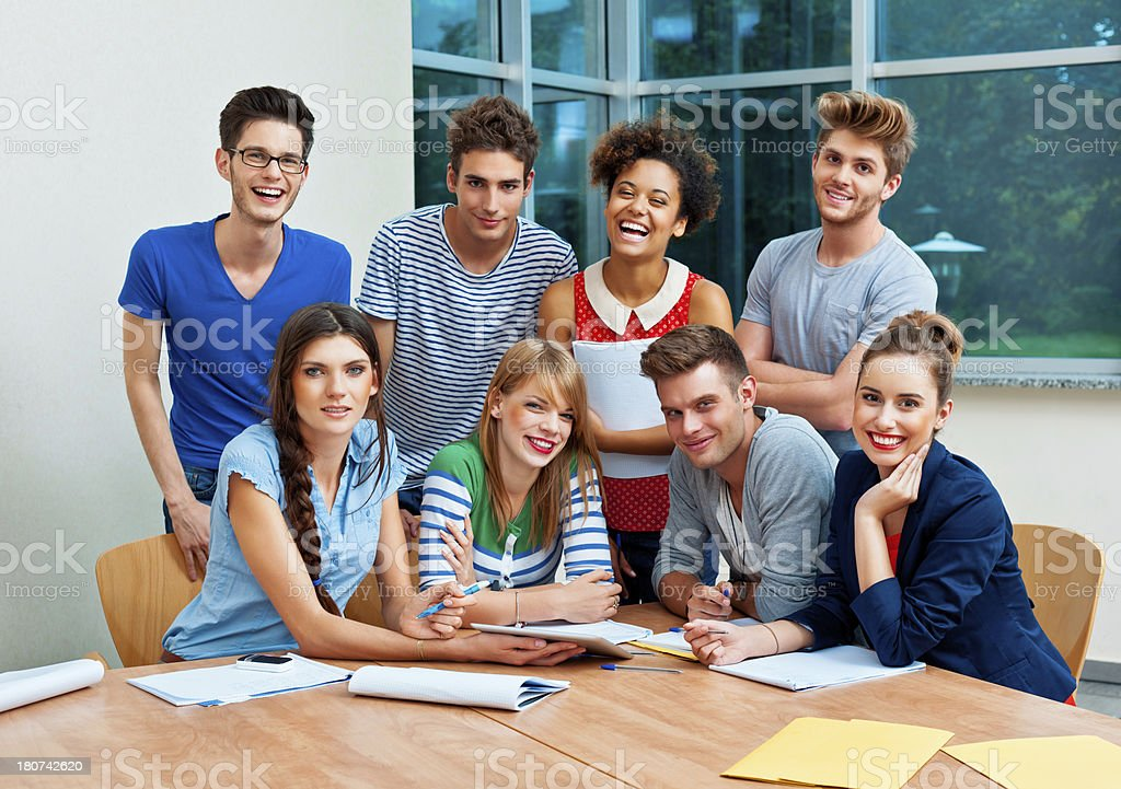Students at the college Group of cheerful college students smiling at the camera. 20-24 Years Stock Photo