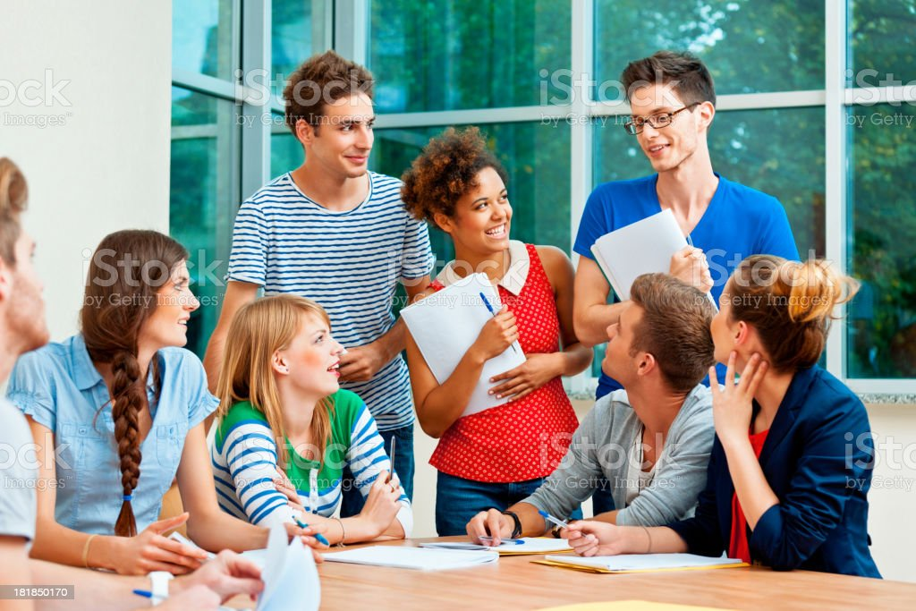 Students at the college Group of cheerful college students working together. 20-24 Years Stock Photo