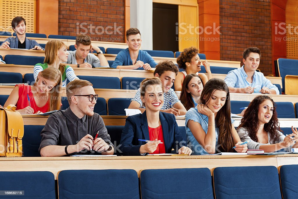 Students at the lecture Large group of cheerful high school students sitting in the lecture hall at university. 20-24 Years Stock Photo