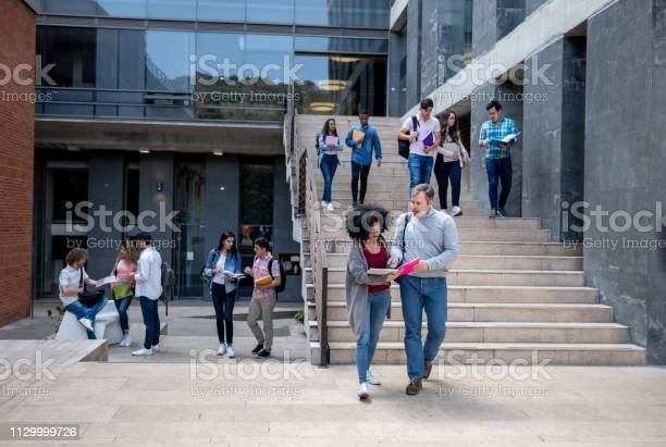 Students at the university campus walking to and from class and a picture id1129999726?b=1&k=6&m=1129999726&s=612x612&h=lata9gsgijmkhnlc1zaetdxlphcwkyzyvbdxjiyvome=