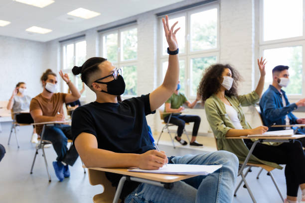 Students at university during coronavirus pandemic stock photo