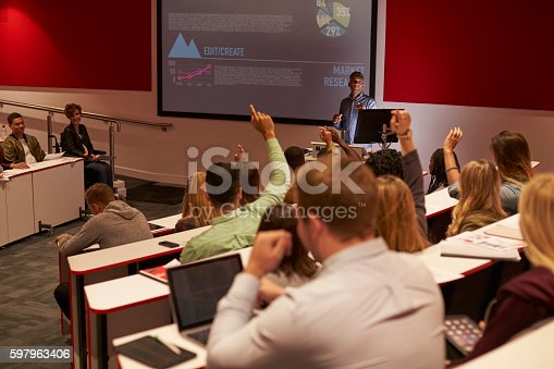 istock Students at university lecture raise hands to ask questions 597963406