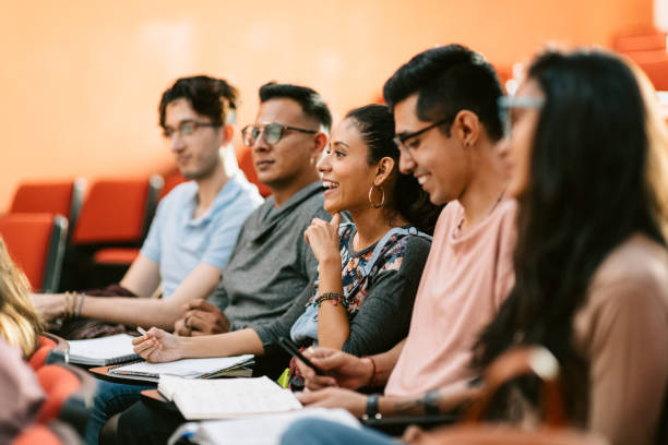 Students attending a lesson in lecture hall stock photo