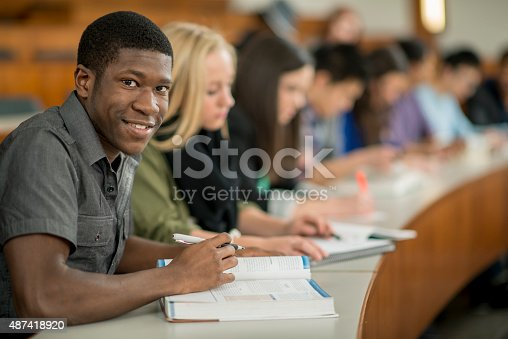 istock Students Attending Lecture at School 487418920