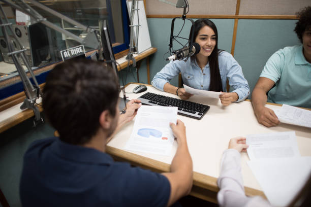 Students broadcasting from the university's radio station stock photo
