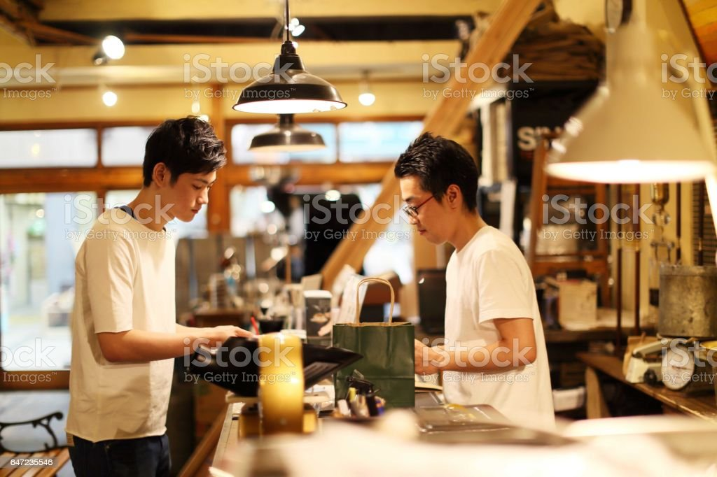 Students buying coffee beans sold by weight stock photo