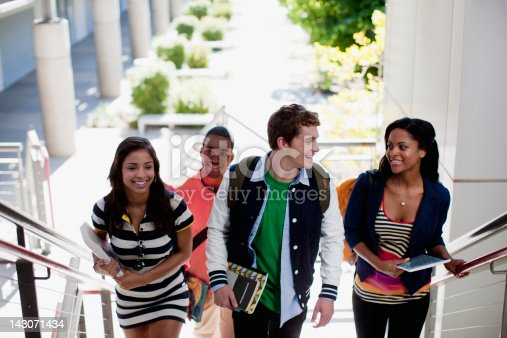 istock Students climbing steps together 143071434