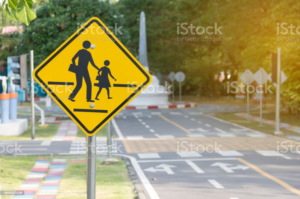 Students crossing ahead sign stock photo