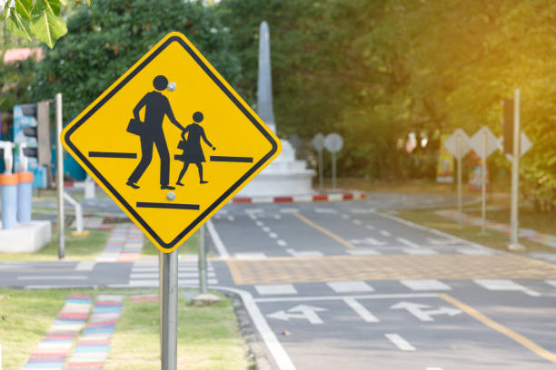 Students crossing ahead sign Students crossing ahead sign time zone stock pictures, royalty-free photos & images