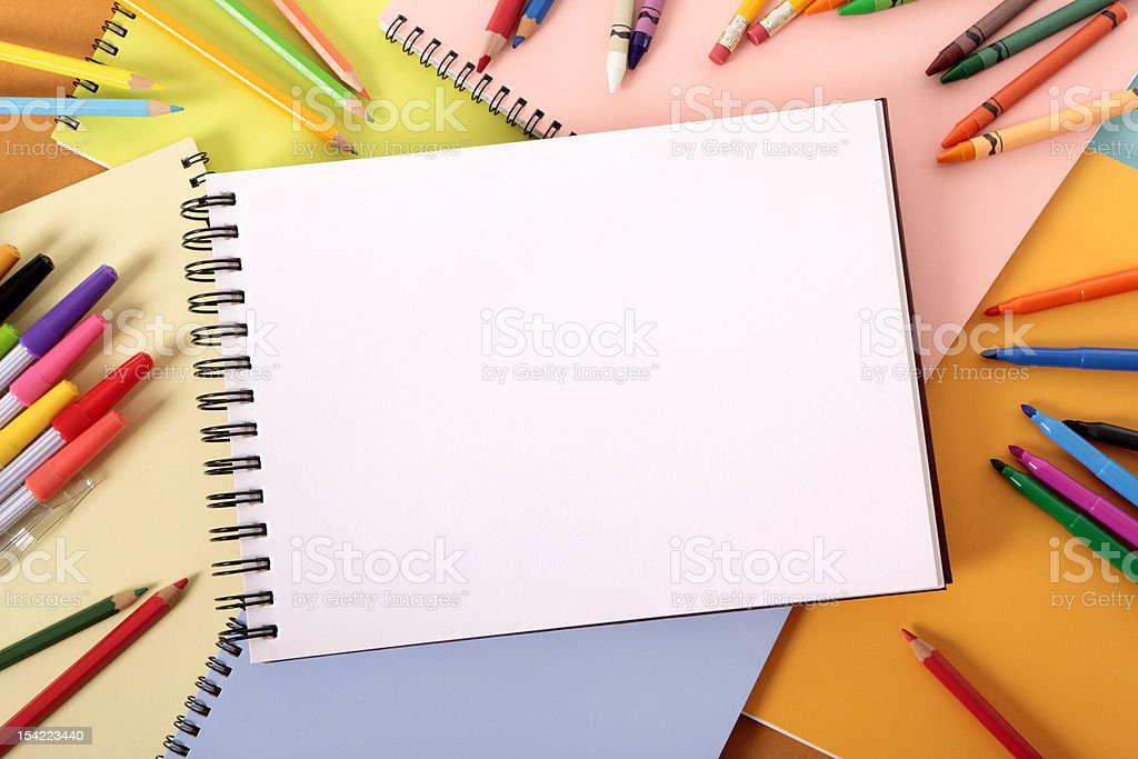 Student's desk with blank art book royalty-free stock photo