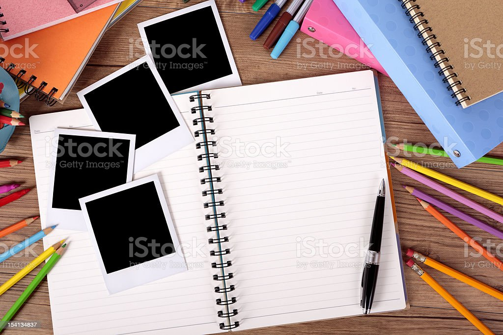 Student's desk with blank holiday photos royalty-free stock photo