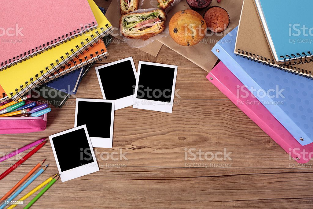 Student's desk with blank photos royalty-free stock photo