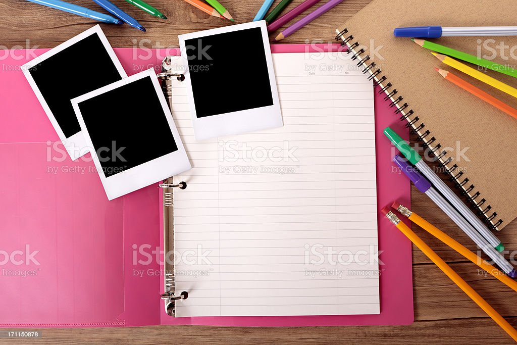 Student's desk with blank photos stock photo