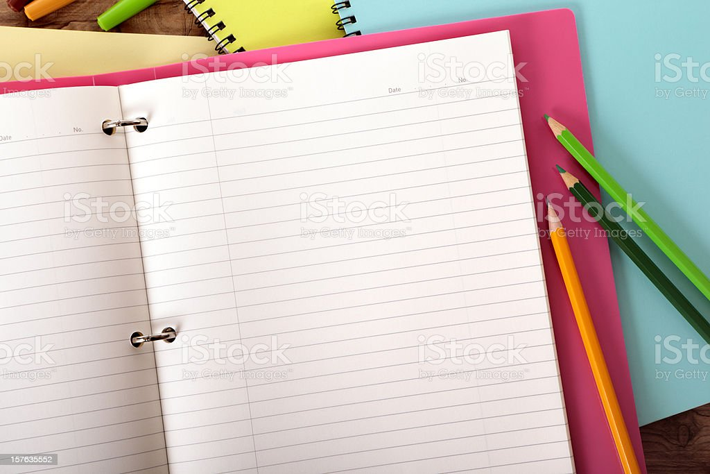 Student's desk with pink project folder royalty-free stock photo
