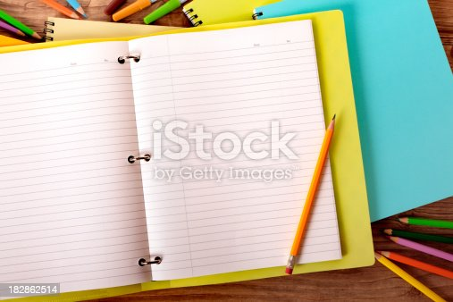 istock Student's desk with yellow project folder 182862514