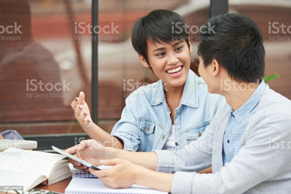 Students discussing project royalty-free stock photo