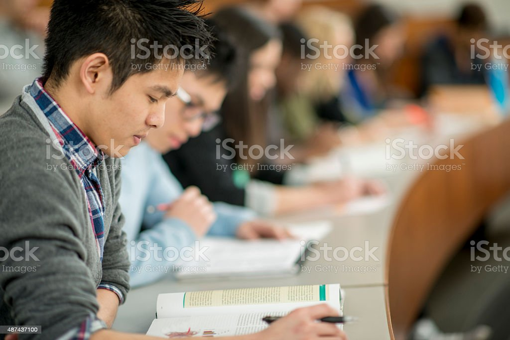 Students Doing an Assingment in Class stock photo