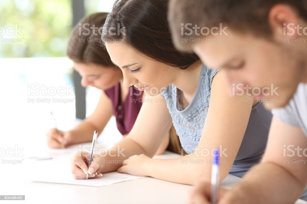 Students doing an exam in a classroom stock photo