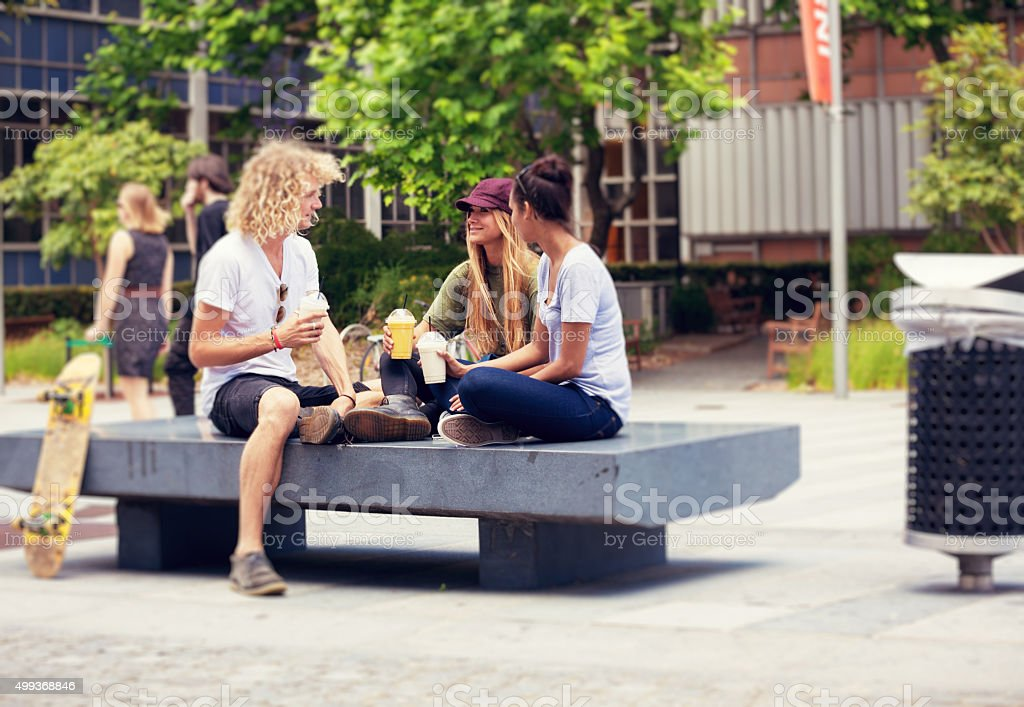 students enjoying being outdoors stock photo
