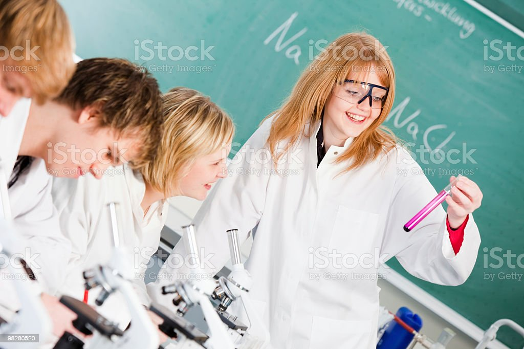 Students examining a test tube royalty-free stock photo