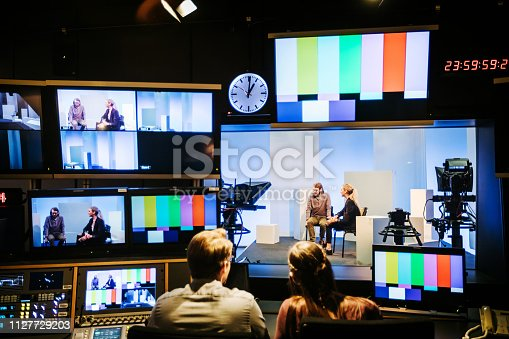 A group of university students experimenting with and learning how to useTv studio equipment.