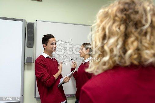 istock Students Explaining Math at Secondary School, University inIstanbul, Turkey 523691157