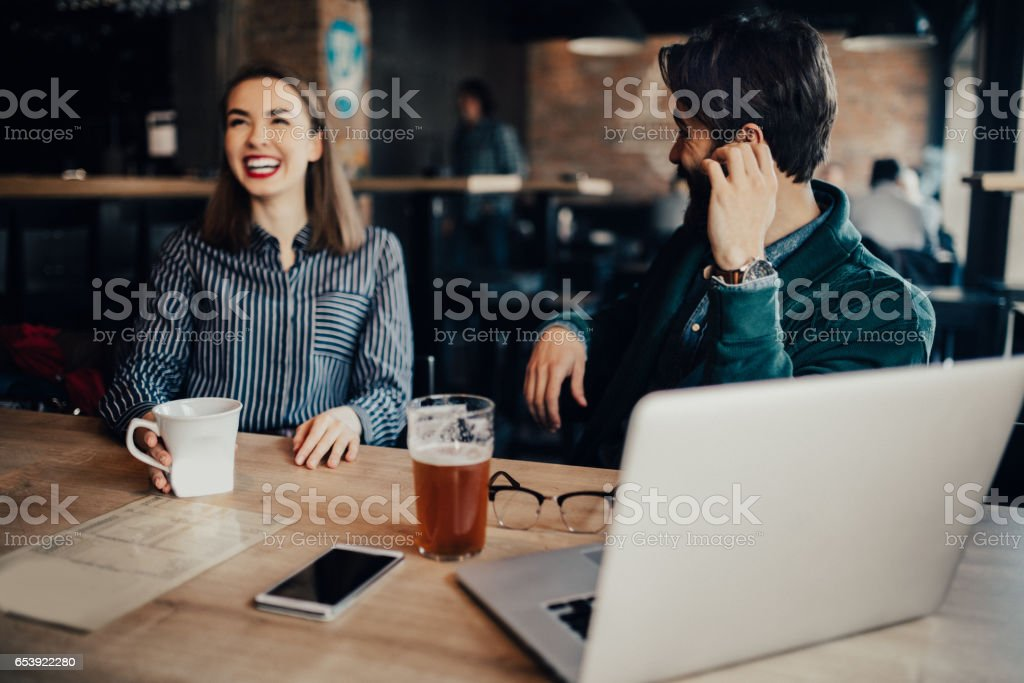 Students flirting in a bar stock photo